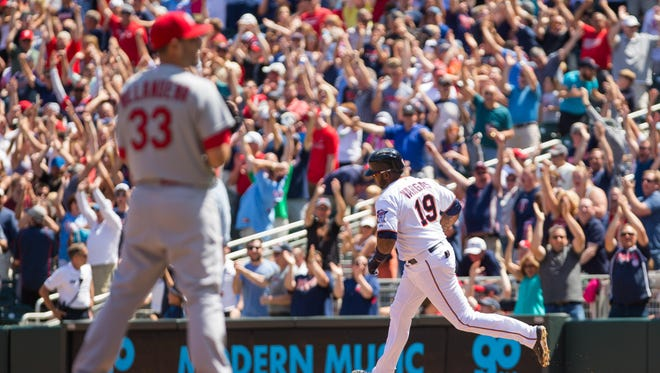 Minnesota Twins first baseman Kennys Vargas (19) hits a walk off home run in the ninth against St Louis Cardinals relief pitcher Carlos Villanueva (33) at Target Field.