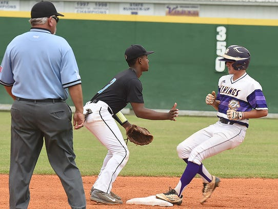 An Opelousas Catholic player makes it on base during