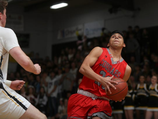 Foothill's Jonny Cruz takes the ball to the basket