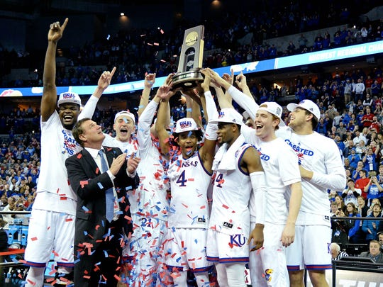 Bill Self and the Jayhawks celebrate their Midwest