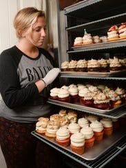 Brandi Lindoe of Clemson Confectioneries checks over