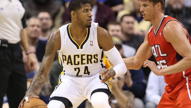 Indiana Pacers forward Paul George (24) is guarded by Atlanta Hawks forward Kyle Korver (26) at Bankers Life Fieldhouse.