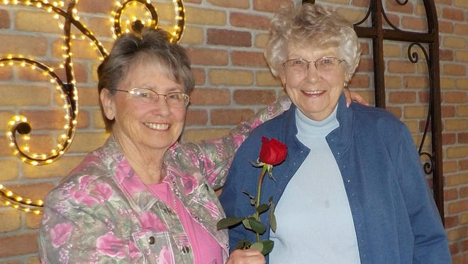 In late May, Taffy Williams was recognized for her 50 years of membership in the Wausau Women's Club. Molly Hoffmann, at that time a board member, is pictured with Taffy, presenting her with a rose, a special 50-year pin and a couple of letters of congratulations. Mary Staples was also honored for 60 years of membership, but was unable to attend.