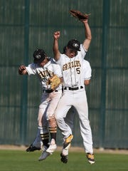 Galena outfielders Mateo Lemus, left, Austin Crofoot  and Charles Douglas celebrate a win against Carson on Tuesday.
