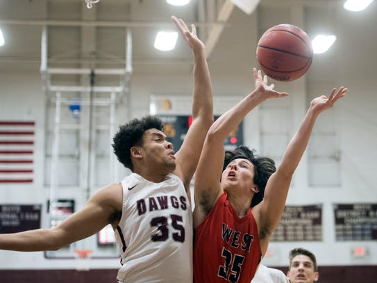 West's Matthew McIntyre is defended by Bearden's Shamarcus