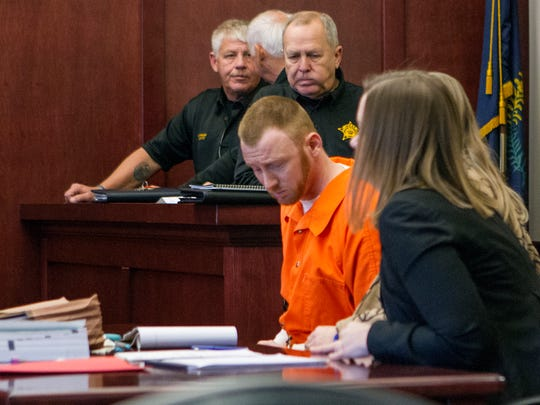 Ryan Champion, center, sits with his attorney during a hearing Thursday Dec. 8, 2016, in Trigg County Circuit Court in Cadiz, Ky. Champions, charged with orchestrating the slayings of his parents, sister and an acquaintance who was hired to kill the family, avoided the death penalty by pleading guilty Thursday to four counts of murder.   (Kat Russell/The Paducah Sun via AP)