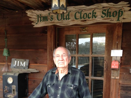"Jimmy Hayes stands in front of his ""Old Clock Shop"" at his home off off Esler Field Road in Pineville."
