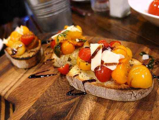 Bruschetta tradizionale with tomatoes, garlic, basil and extra-virgin olive oil at Fabio On Fire.
