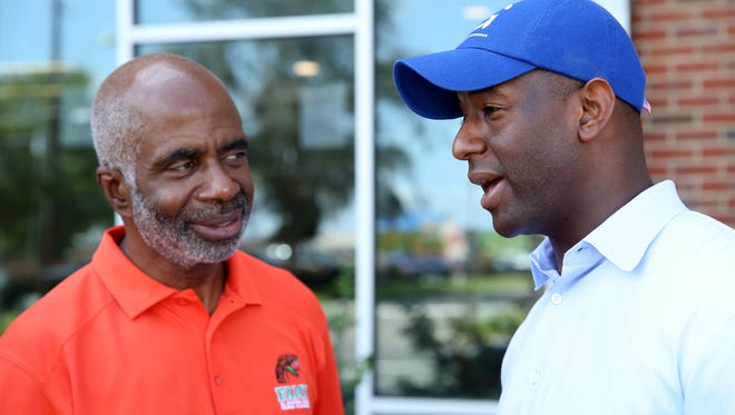 Mayor Andrew Gillum (right) speaks with FAMU Interim President Larry Robinson at FAMU Village where he visited during student move-in day August 22.