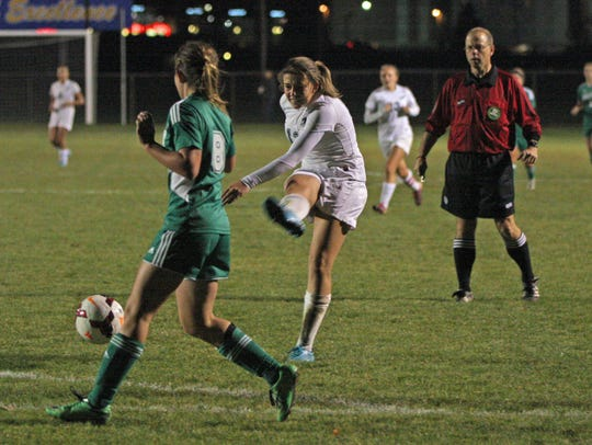 Oak Harbor's Emma Barney sends a shot skipping just