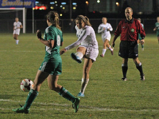 Oak Harbor's Emma Barney sends a shot skipping just wide of the post Tuesday.