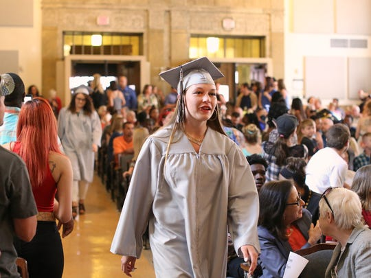 Kelsey walks into the auditorium for her high school graduation. As each of the 42 graduates made their way to the stage, the crowd clapped, yelled and took photos. In this community, high school graduation is a big deal. The entire neighborhood celebrates.