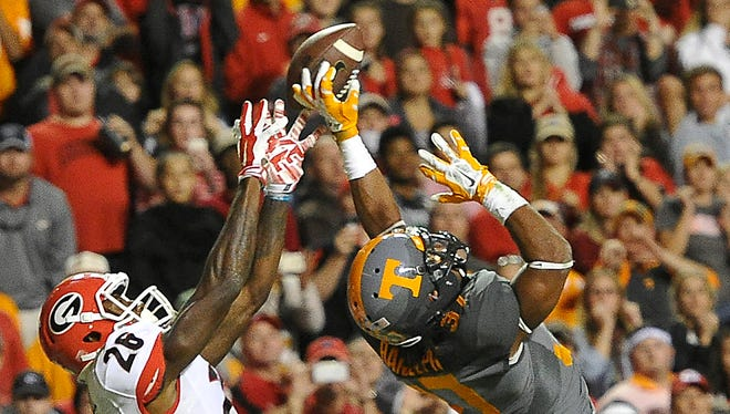 Tennessee defensive back Brian Randolph (37) breaks up a pass intended for Georgia wide receiver Malcolm Mitchell (26) on Saturday in Knoxville.