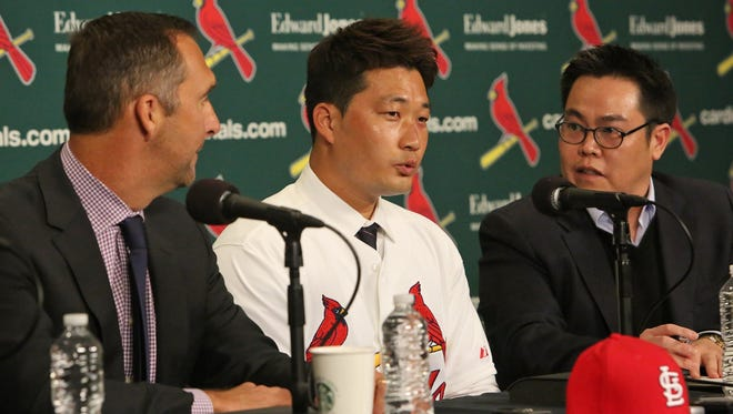 St. Louis Cardinals Senior Vice President/ General Manager John Mozeliak introduces the newest Cardinals pitcher Seung Hwan Oh on Monday, Jan. 11, 2016, during a news conference at Busch Stadium. At right is agent and translator Douglas Kim.