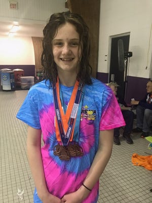"""Linzay Taylor had six top 8 finishes including a 3rd place (bronze) finish in the 100 backstroke.  She improved in all six of her individual events achieving """"AA"""" times in each."""