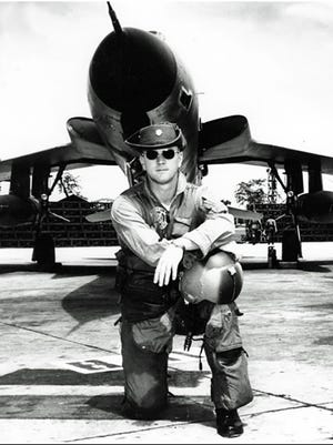 Lt. Col. Gene Smith with his F-105 in Vietnam around 1967 not long before he was captured and held for five and a half years as a POW.