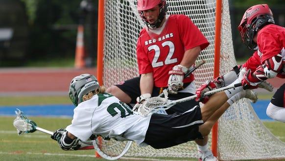 Jamesville-Dewitt goalie Dylan Fleischmann (22) stops