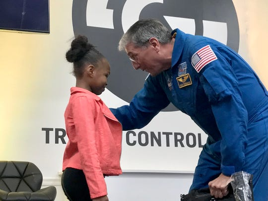 Don Thomas, former NASA astronaut, presents a prize bag to Lonsdale Elementary School student Anya Brawner at a GRIDSMART technology conference Wednesday, Nov. 15, 2017.