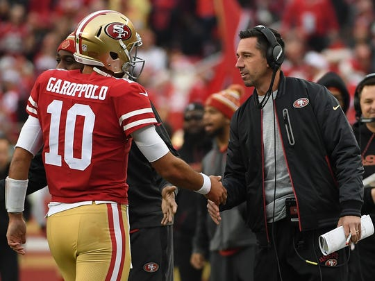 San Francisco 49ers coach Kyle Shanahan congratulates Jimmy Garoppolo after a one-yard touchdown run against the Jacksonville Jaguars in 2017.