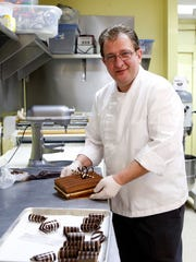 Owner Didier Dumas decorates a cake at Patisserie Didier Dumas in Nyack in 2015.