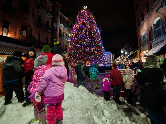 The crowd watches as the tree is illuminated during the ceremony at the top of Church Street.