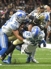 Lions safety Miles Killebrew (35) appears blocked for
