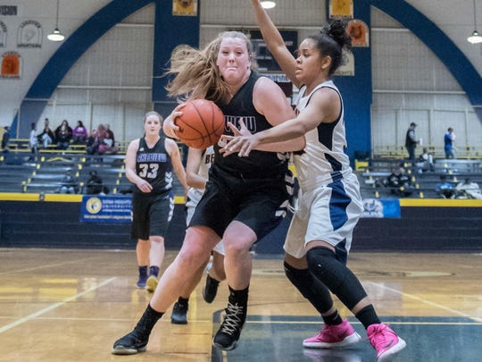 Lakeview's Emily Eldridge (44) is defended by Battle Creek Central's Tamera Gills.