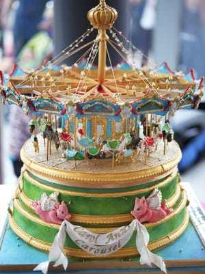Sugar Realm Fine Bakery & Cake Design created a replica carousel cake for the opening of the Carol Ann's Carousel in Smale Riverfront Park Saturday, May 16, 2015.