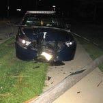Police car crashes into power pole