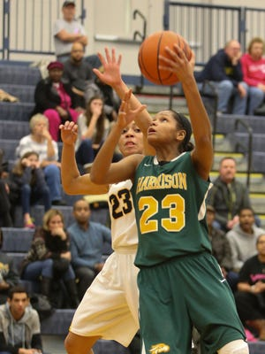Clarkston's Kayla Russell defends against Farmington Hills Harrison's Kristen Nelson during the fourth period Friday at Clarkston