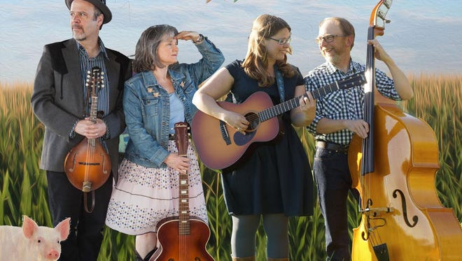 Paper Birds -- the folk singing duo of Claudia Russell and Katie Dahl, center, and their husbands, Bruce Kaplan (left) and Rich Higdon -- are in concert March 23 at Old Gibraltar Town Hall.