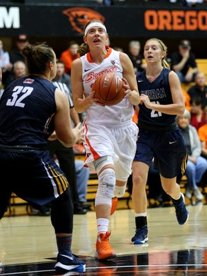 Oregon State guard Sydney Wiese (24) drives to the basket against Corban during an exhibition game inside Gill Coliseum, Sunday, November 8, 2015, at Oregon State University in Corvallis, Ore. Oregon State won the game 98-48.