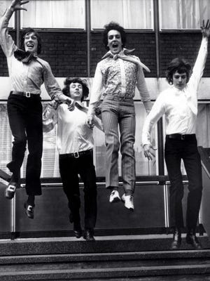 On the threshold of stardom, members of the psychedelic rock band Pink Floyd leap from the steps of EMI House in London on March 3, 1967. From left: Roger Waters, Nick Mason, Syd Barrett and Richard Wright.