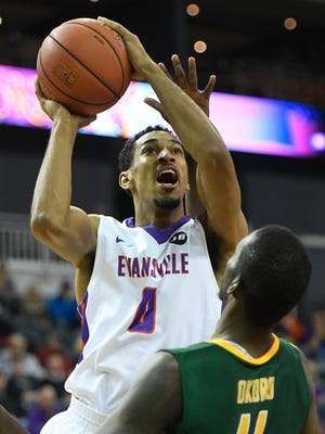 Evansville's Ryan Taylor shoots over Norfolk State's Kerwin Okoro as the University of Evansville Purple Aces play the Norfolk State Spartans at the Ford Center in Evansville Wednesday, December 14, 2016.