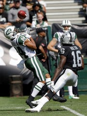 New York Jets' Kalif Raymond, left, fumbles a punt in front of Oakland Raiders' Johnny Holton, which Holton recovered, during the first half of an NFL football game in Oakland, Calif., Sunday, Sept. 17, 2017. (AP Photo/Marcio Jose Sanchez)