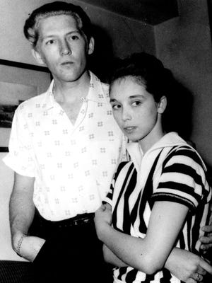 """American """"rock n'' roll"""" singer and pianist Jerry Lee Lewis and his fifteen year-old wife Myra pause for a photograph May 23, 1958 at the Westbury Hotel in London."""
