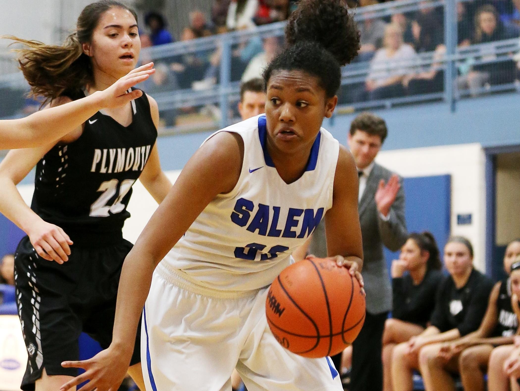 Salem senior Zoe Talley (No. 33) makes an aggressive push toward the basket Tuesday against Plymouth. Talley later left the season opener with a leg injury.