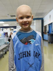 Liam Craane, 5, who was adopted by the John Jay field