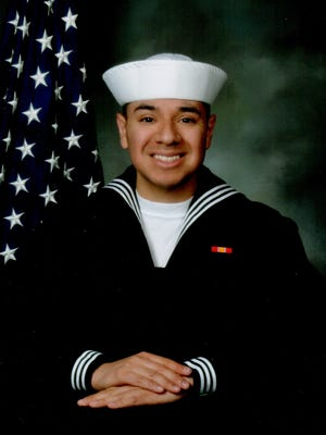 Seaman Corey L. De La Cruz