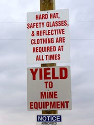 Safety signs are seen outside a frac sand mine owned