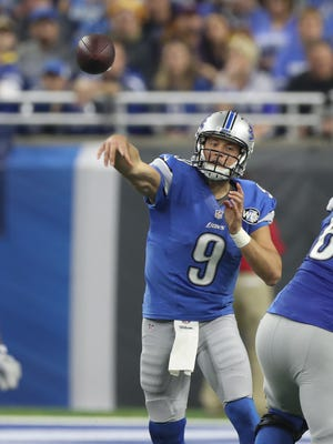 Lions quarterback Matthew Stafford passes against the Minnesota Vikings in the second half Thursday, Nov. 24, 2016 at Ford Field in Detroit.
