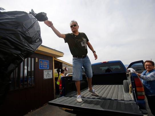 Tony Henry throws away trash April 4, 2016, at a transfer