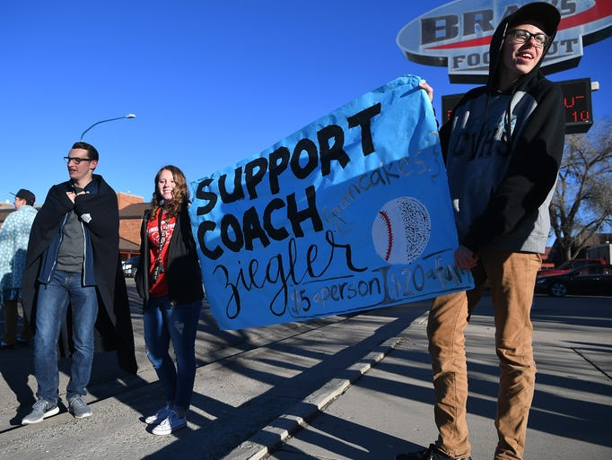 Canyon View High School students wave a banner outside