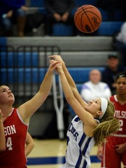 Cedar Crest's Jade Rolon, right, attempts to pull down