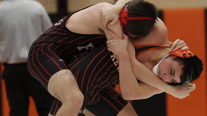 Kewanee's Diego Jackson wrestles with Fulton's Elijah Stillings during a bout in the 152-pound weight class on Thursday at Brockman Gymnasium.