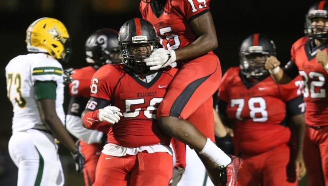 Hillcrest senior defensive linemen Amari Houston (56) and Malik Ladson (15) celebrate a big play against Laurens Sept. 30. Houston, Ladson and the Rams will play at T.L. Hanna Friday night in a Class AAAAA first-round playoff game.