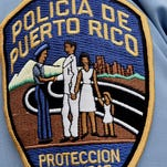A Puerto Rico police officer's shoulder patch. Three members of the agency were shot to death Dec. 28, 2015, at police headquarters in Ponce.