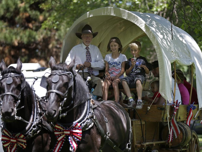 Rodger Cavanaugh gives carriage ridws during CommunityFest at Riverside Park on July 4, 2014 in Neenah, Wis.