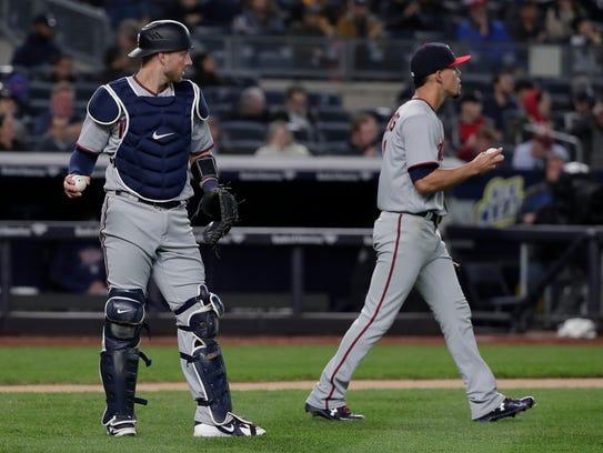 Minnesota Twins catcher Mitch Garver, left, and pitcher