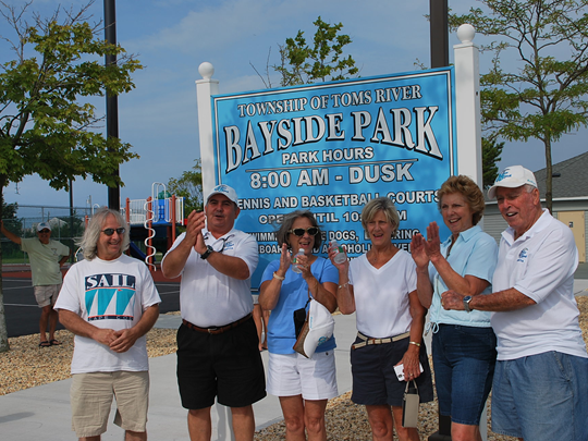 Ortley Beach Voters and Taxpayers Association officials in front of sign for Bayside Park, which was recently reopened after it was badly damaged by superstorm Sandy.
